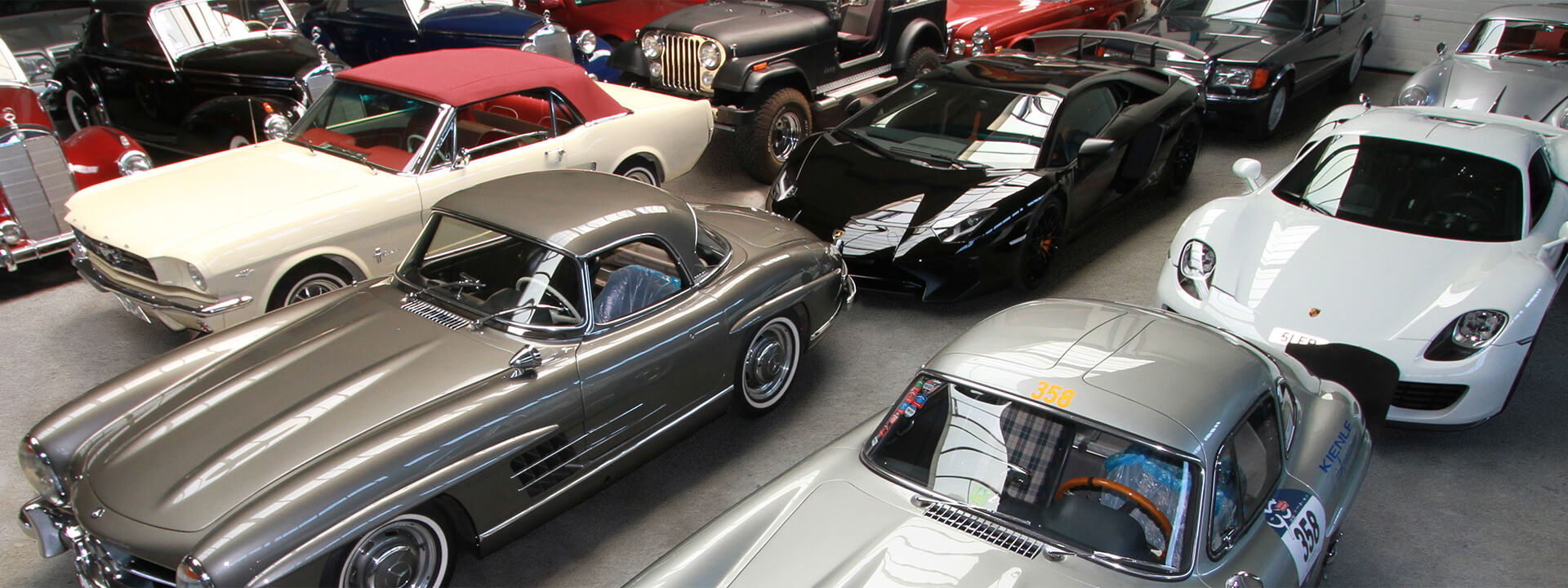The Mercedes 300 SL and other supercars and classic cars in the Kienle showroom